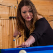 Young woman playing pool — Stock Photo