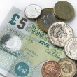 Fiver and coins — Stock Photo #25313113