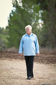 Active senior woman walking . — Stock Photo