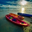 Kayaks sunset on beach — Stockfoto