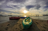 Kayaks sunset on beach — Stock Photo