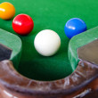 Snooker balls  on green surface near pocket — Stock Photo