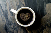 Cup coffee with heart symbol — Stock Photo