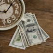 Stock Photo: Close up, Time and Money on wood table