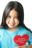 Girl asian black haired girl holding an heart-shaped — Stock Photo