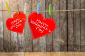 Cute big red heart hanging on the clothesline. On old wood background. — 图库照片