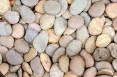 Pebble stone in background — Stock Photo