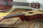Ukuleles  against a wooden background. — Stock Photo