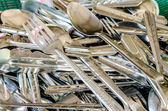 A pile of cutlery :Background image looking at texture, shapes and color of things all around us — Stock Photo