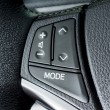Close up of  Audio control knob on a steering wheel — Stock Photo #48611277