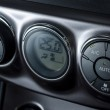 Color detail with the air conditioning button inside a car — Stock Photo #48611445