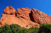 Climbers ascend rock mountain face — Stock Photo
