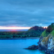 Stock Photo: Cape Disappointment at sunset overlooks bluffs & Waikiki beach