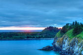 Cape Disappointment at sunset overlooks bluffs & Waikiki beach — Stock Photo