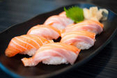 Close up of Salmon Sushi Set on Black Dish — Stock Photo
