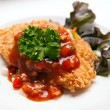 Stock Photo: Deep fried fish steak with sauce and vegetables