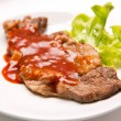 Grilled beef steak with sauce and vegetables — Stock Photo