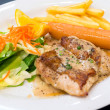 Chicken steak with sausage, salad, french fries and pepper sauce on white dish — Stock Photo #39945133