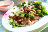 Delicious food in Northeast of Thailand made from deep fried pork, chili, garlic and basil — Foto Stock