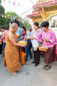 Nonthaburi, THAILAND - Jan 1, 2014 Unidentified Buddhist monks are given food offering from people in the morning for New Year Day on January 31, 2014 in Sak Yai Temple, Nonthaburi Thailand — Stock Photo