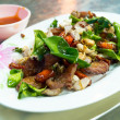 Delicious food in Northeast of Thailand made from deep fried pork, chili, garlic and basil — Stock Photo #39967123