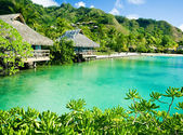 Over water bungalows and a green lagoon — Stock Photo