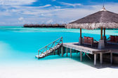 Over water jetty with steps into tropical lagoon — Stock Photo