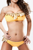 Hot babe in yellow bikini suite standing — Stock Photo