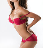 Sexy vrouw in rode lingerie — Stockfoto