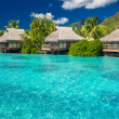 Overwater villas in lagoon of Moorea Island — Stock Photo #45349901