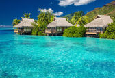 Overwater villas in lagoon of Moorea Island — Stock Photo