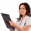 Happy smiling female doctor writing on clipboard, isolated on wh — Stock Photo #15605109