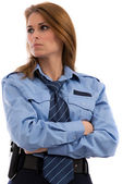 Beautiful lady in a uniform of police officer on a white backgro — Stock Photo