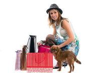 Lady with dog shopping isolated on white background — Stock Photo