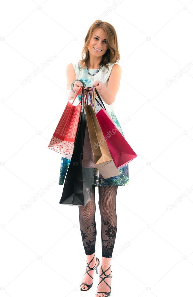 Lovely Woman with shopping bags on white background — Stock Photo #16632461