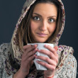Royalty-Free Stock Photo: Portrait of a beautiful young woman drinking coffee