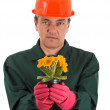 Gardener with a flowerpot in hand - Foto Stock