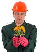 Gardener with a flowerpot in hand — Stock Photo