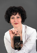 Portrait of a beautiful woman with a camera classic — Stock Photo
