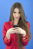 Young businesswoman talking on smart phone — Stock Photo