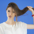 Young Woman with long Hair on blue background — Stock Photo