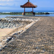 Rest-houses at sanur beach on bali — Stock Photo
