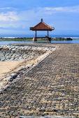 Rest-houses at sanur beach on bali — Stock Photo