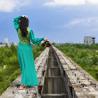 Attractive young lady posing somewhere in industrial ruins — Stock Photo