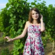 Elegant young woman outdoor portrait lean on wall covered in vin — Stock Photo