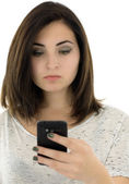 Beautiful young woman looks in phone isolated on white backgroun — Stock Photo