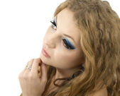 Glamour young woman with blue eye make-up and curly hairstyle on — Stock Photo