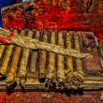 Traditional handmade cigars in storage press — Stock Photo