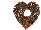 Heart from coffee beans with a hole in the middle — Stock Photo