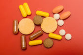 Different drugs isolated on red background — Stock Photo